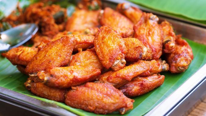 "Close up of Fried chicken wings thai street food market""r""n."