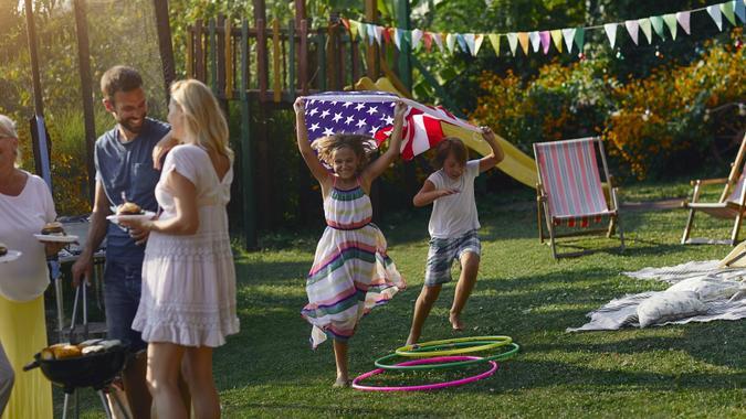 Multi-generation Family Celebrating 4th of July stock photo