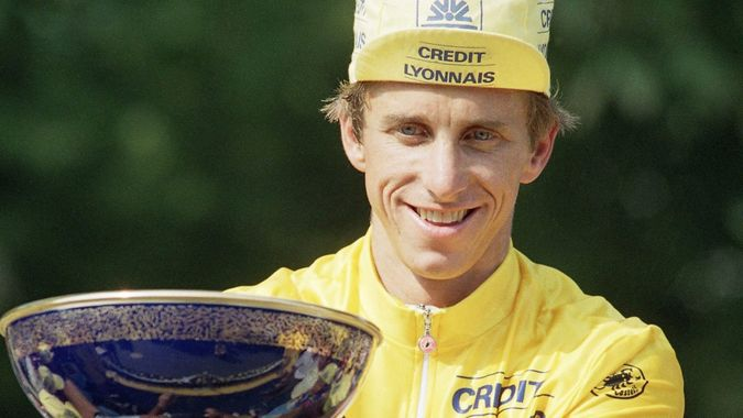 Mandatory Credit: Photo by Laurent Rebours/AP/Shutterstock (7275283a)United Statuss Greg LeMond reacts as he holds the cup after his victory in the Tour de France classic at the end of the last stage, Paris, FranceGreg LeMond Tour de France 1990, Paris, France.