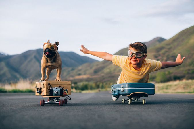 A young boy and his French Bulldog are ready to travel the world.