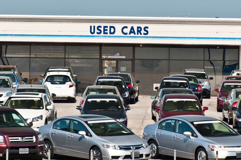 Alcoa, Tennessee, USA - April 10, 2011: The used car lot of a Honda dealer is dominated by late model used Hondas with a banner proclaiming them to be certified, that is to have a full Honda warranty.