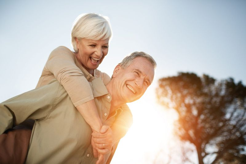 Cropped shot of a senior man giving his wife a piggyback outdoorshttp://195.