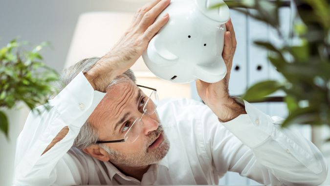 Adult man with piggy bank.