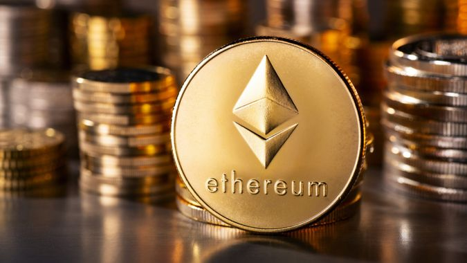 Frankfurt, Hesse, Germany - April 12, 2018: Cryptocurrency coin Ethereum with several stacks of coins in the background.