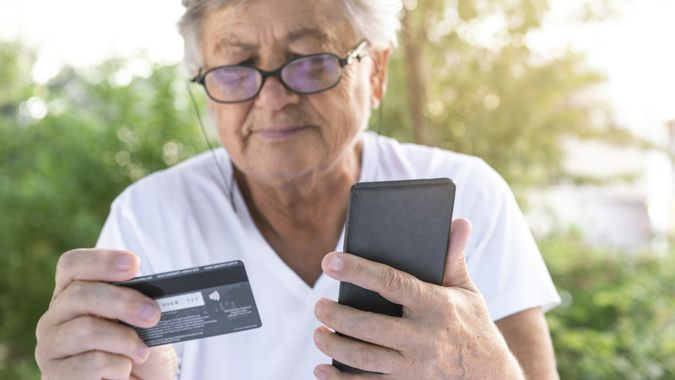 Senior Woman With Credit Card stock photo