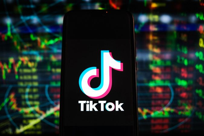 Mandatory Credit: Photo by Omar Marques/SOPA Images/Shutterstock (11876645al)In this photo illustration a TikTok logo is displayed on a smartphone with stock market percentages in the background.