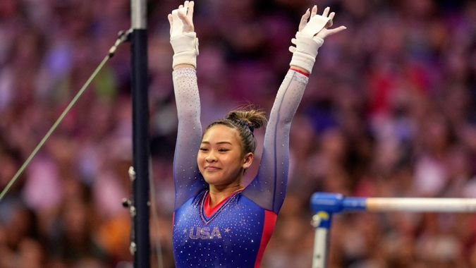 Mandatory Credit: Photo by Jeff Roberson/AP/Shutterstock (12170002l)Suni Lee reacts to her performance on the uneven bars during the women's U.