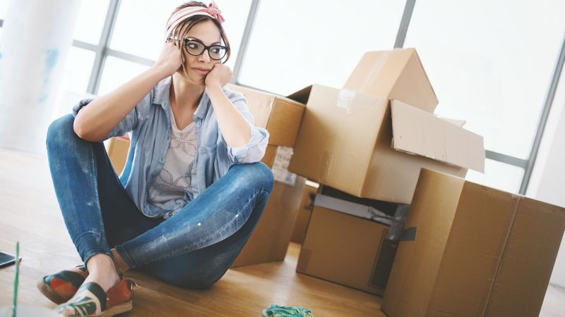 Moving in can be quite exhausting. stock photo