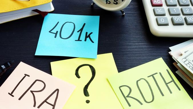 401k ira roth on pieces of paper. Retirement planning. stock photo