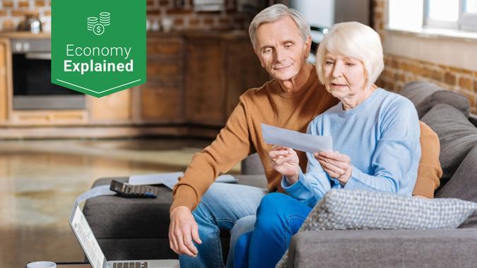 elderly couple receiving social security check