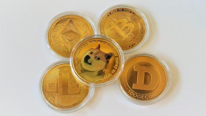 San Diego, CA June 10, 2021  Close up of assorted cryptocurrencies like bitcoin, dogecoin, ethereum, litecoin on white background illustrating concept of exchange cryptocurrency, new virtual money.