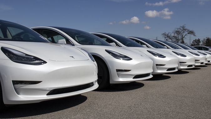 Tesla electric vehicles awaiting preparation for sale. Tesla EV Model 3, S and X are a key to a cleaner and greener environment. stock photo