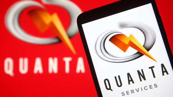 Mandatory Credit: Photo by Pavlo Gonchar/SOPA Images/Shutterstock (12205310a)In this photo illustration a Quanta Services logo is seen on a smartphone and a pc screen.