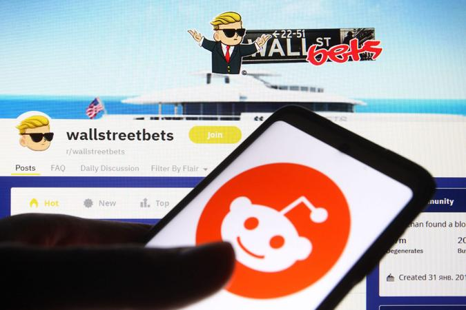 Mandatory Credit: Photo by Pavlo Gonchar/SOPA Images/Shutterstock (11751613z)In this photo illustration a Reddit logo is seen on a mobile phone screen in front of WallStreetBets (WSB) logo of a subreddit where participants discuss stock and options trading.