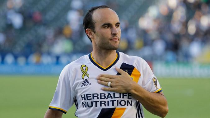 Mandatory Credit: Photo by Jae C Hong/AP/Shutterstock (11881836a)Los Angeles Galaxy's Landon Donovan acknowledges fans after the team's MLS soccer match against Orlando City in Carson, Calif.