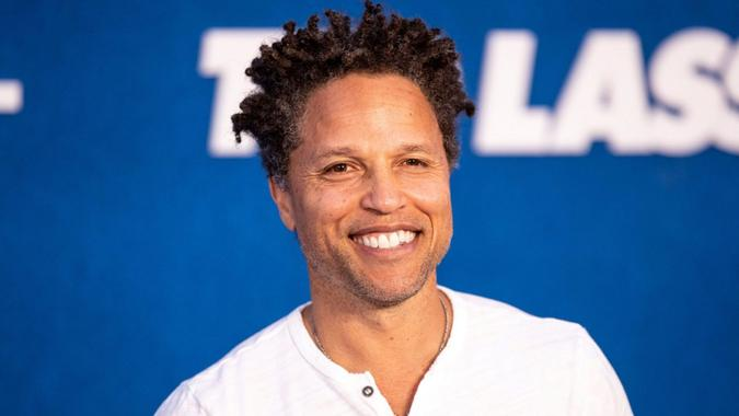 Mandatory Credit: Photo by ETIENNE LAURENT/EPA-EFE/Shutterstock (12216742q)US former soccer player Cobi Jones poses prior to the premiere of the Apple's 'Ted Lasso' Season 2 at Pacific Design Center in Hollywood, California, USA, 15 July 2021.