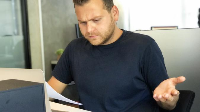 A angry man in bad financial situation stress at office stock photo