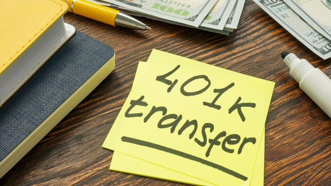 401k transfer to another retirement plan sign and money. stock photo