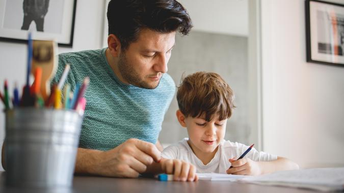 Father and Son doing homework Together stock photo