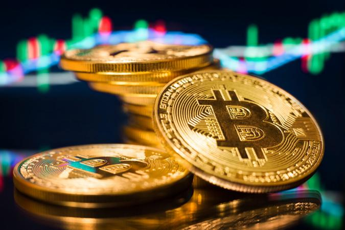 Bitcoin gold coins in a close-up shot, digital currency concept.