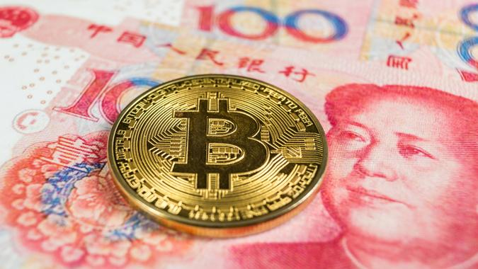 Crypto currency concept - A Bitcoin with Chinece currency RMB, Renminbi.