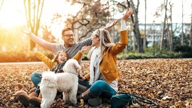 Happy family enjoying together in park.