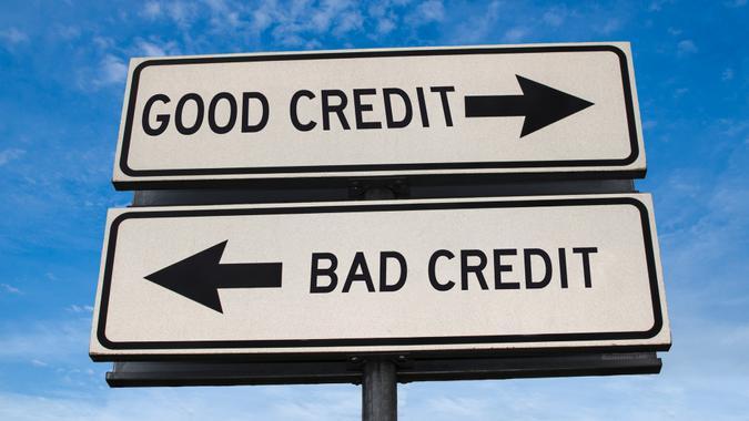 Good credit and bad credit road sign.