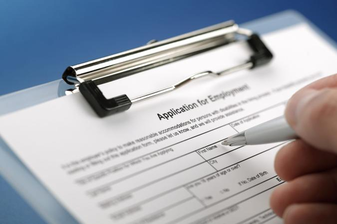 Completing an employment application form.