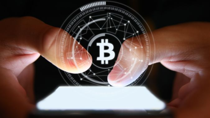 Bitcoin blockchain cryptocurrency mobile phone cyber network internet stock photo