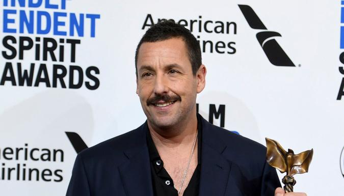 """Mandatory Credit: Photo by Richard Shotwell/Invision/AP/Shutterstock (10551778q)Adam Sandler poses in the press room with the award for best male lead for """"Uncut Gems at the 35th Film Independent Spirit Awards, in Santa Monica, Calif2020 Film Independent Spirit Awards - Press Room, Santa Monica, USA - 08 Feb 2020."""