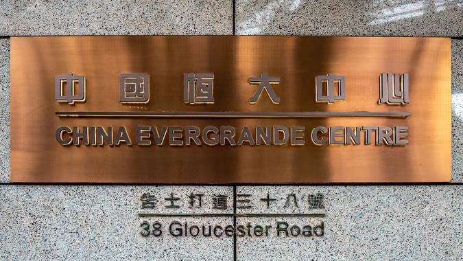 Mandatory Credit: Photo by Katherine Cheng/SOPA Images/Shutterstock (12455130f)China Evergrande Centre sign seen on the front of their building.