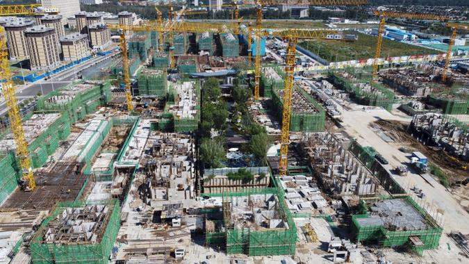 Mandatory Credit: Photo by Uncredited/AP/Shutterstock (12457398f)An aerial view of an Evergrande new housing development project is under construction in Beijing, .