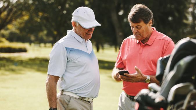 Senior man taking break from golfing stock photo