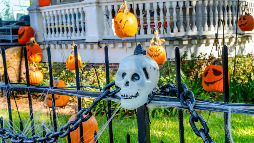 Halloween Pumpkins Decorations Black Iron Gate Fence Garden District New Orleans Louisiana. National Historic District built in the 1800s