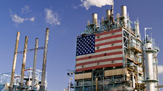Part of oil refinery complex with big american flag displayed.