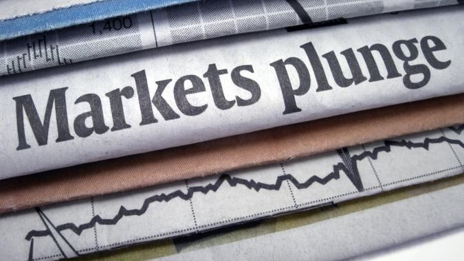 """Newspaper headline """"Markets plunge""""."""