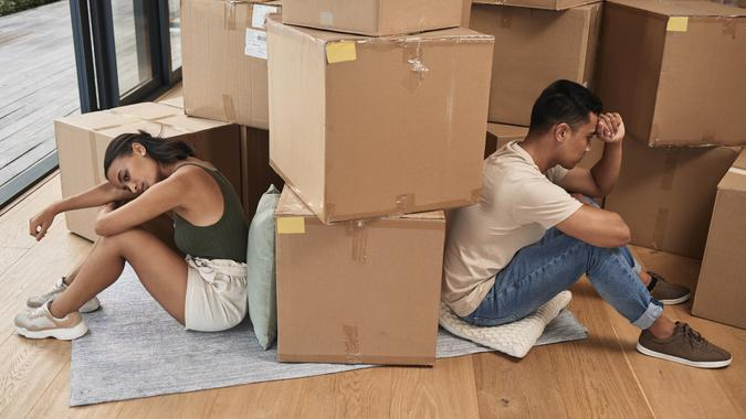 Shot of a young couple ignoring one another at home stock photo