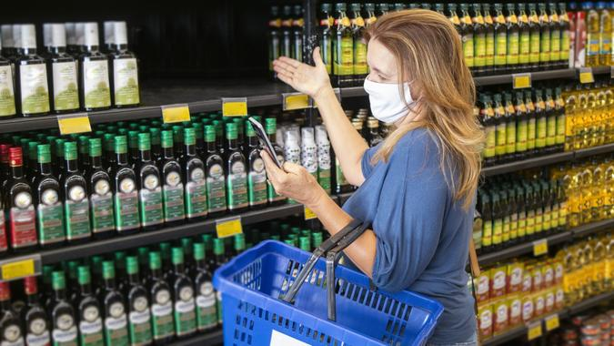 Woman in a supermarket. Out of stock. stock photo