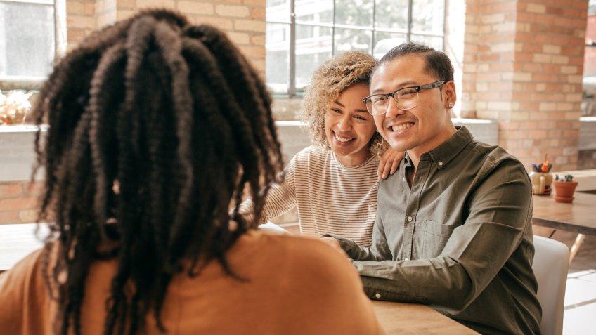 Couple talk with financial advisor.