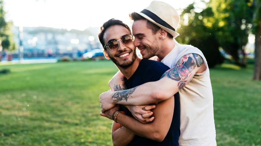 Gay couple traveling across Europe and having farewell moment after spending memorable moments together.