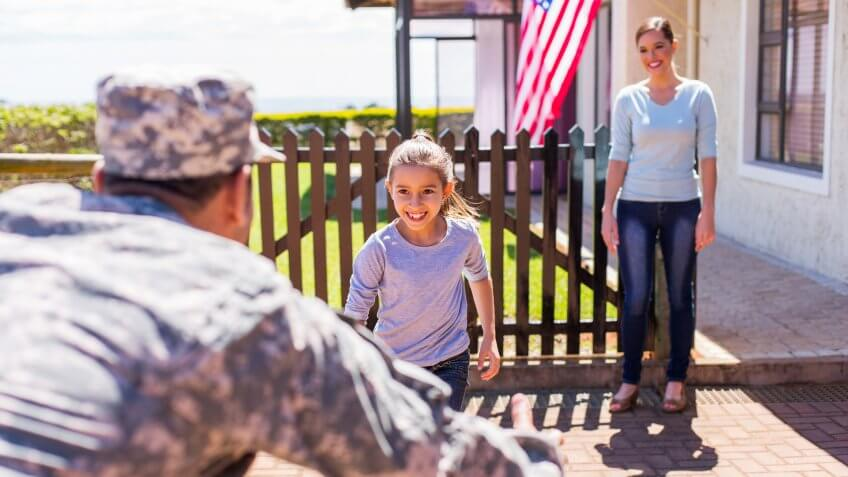 happy young american military family reunion.