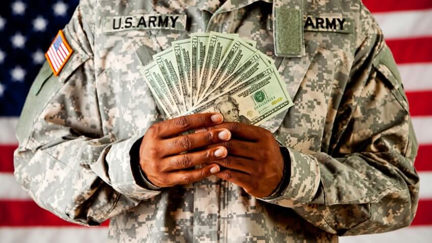 Soldier: Holding Money Fan In Front Of American Flag.