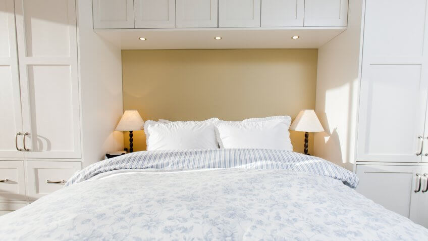 A bedroom with custom built closets.