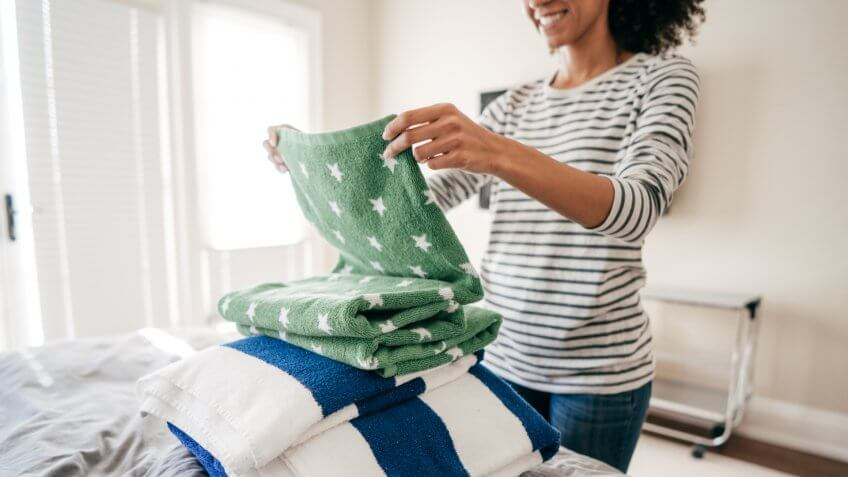 Woman folding towels.