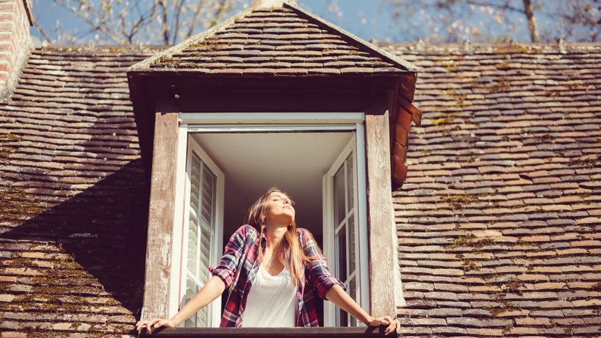 Woman looking through the window - copyspace.