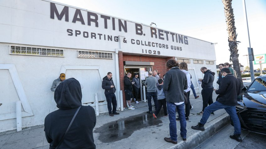 A line is formed outside of a gun store in Culver City in response to the Coronovirus outbreakCoronavirus outbreak, Los Angeles, USA - 17 Mar 2020.