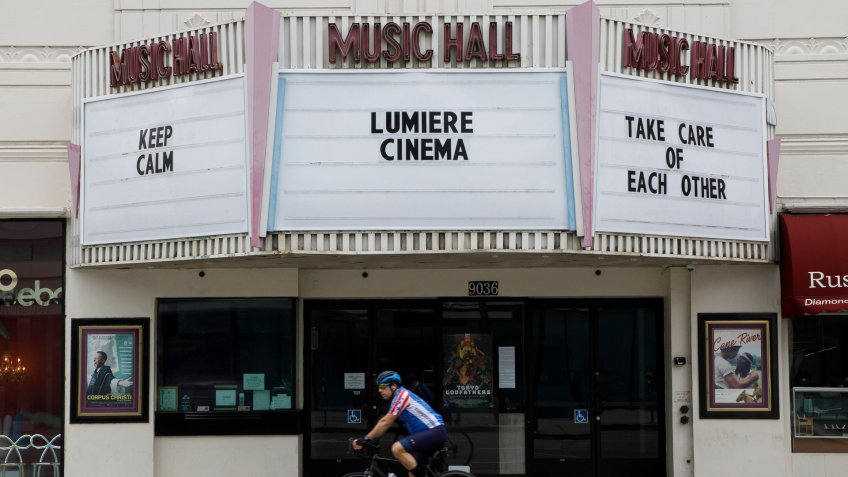 The closed Lumiere Cinema at the Music Hall theater displays a message to passersby during the state of California's shelter in place order due to the coronavirus SARS-CoV-2 which causes the Covid-19 disease in Beverly Hills, California USA, 20 March 2020.