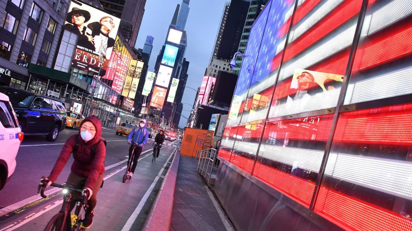 A cyclist wears a face mask in Times Square in Manhattan due to the Coronavirus outbreak.