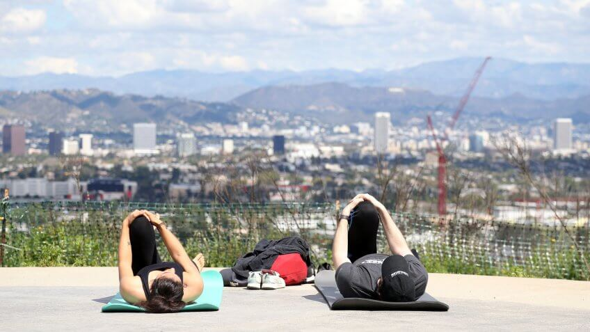 People ignore advice to stay indoors and continue with their workouts at the Culver City Overlook.
