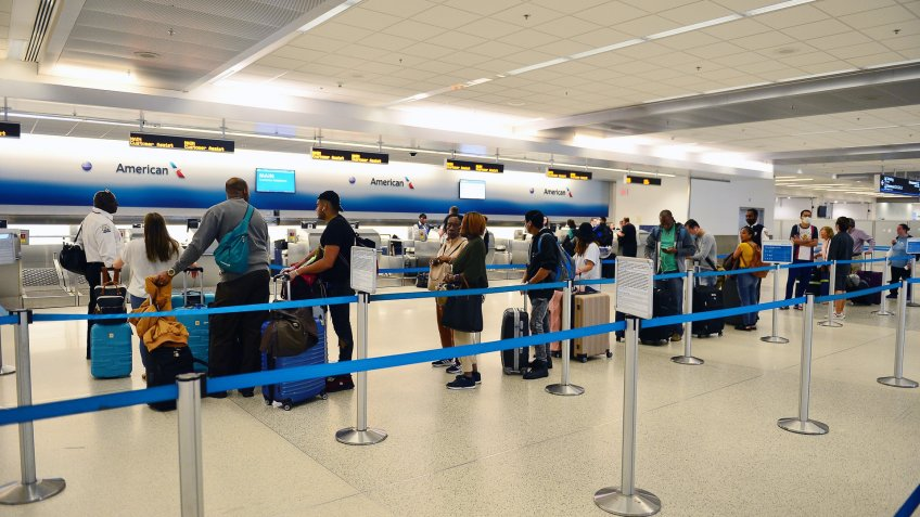 Empty check in lanes are seen at Miami International Airport amid COVID-19 pandemic.